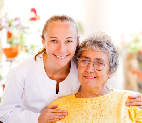 a nurse and senior lady smiling