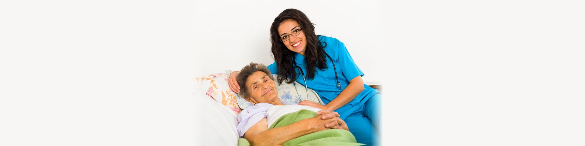 Smiling nurse caring for kind elder patient in nursing home